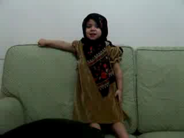 Child Reciting Quran